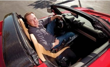 Elon Musk in a Tesla Roadster